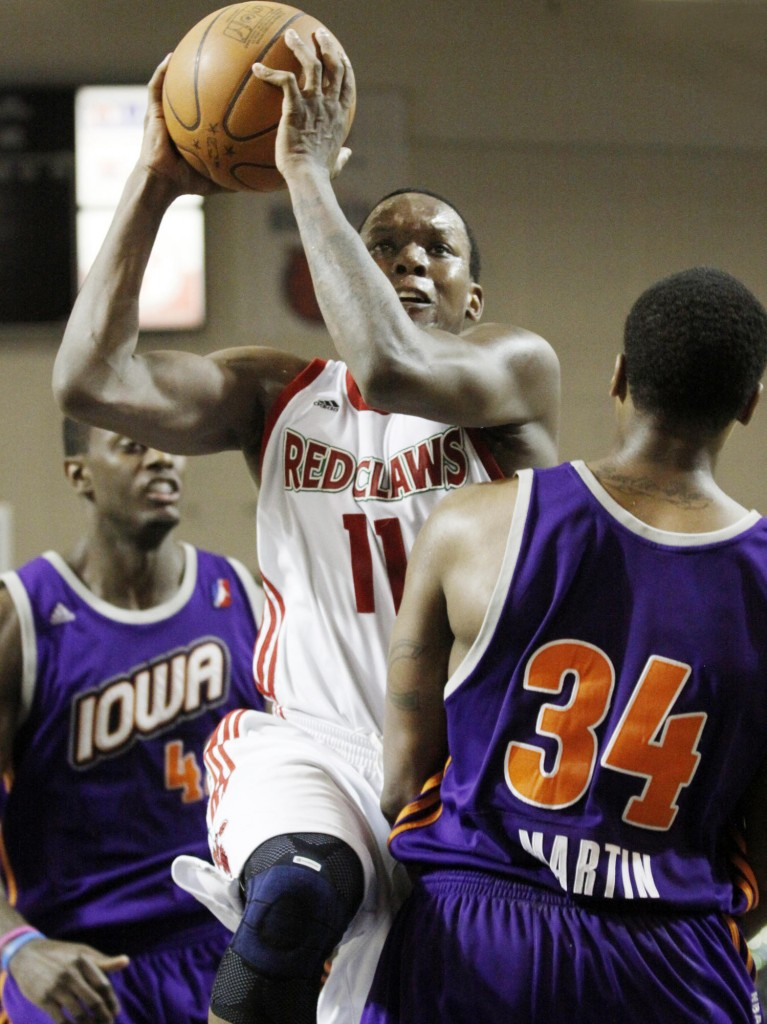 Russell Robinson of the Red Claws splits the Iowa defense on a drive to the basket Sunday night at the Portland Expo. The Energy got double-digit scoring from all five starters and cruised to a win.
