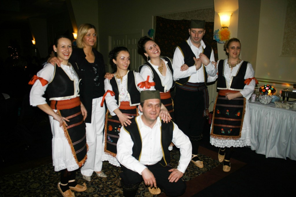 Members of the Serbian dance troupe Kud Sokolica pose for the cameras.
