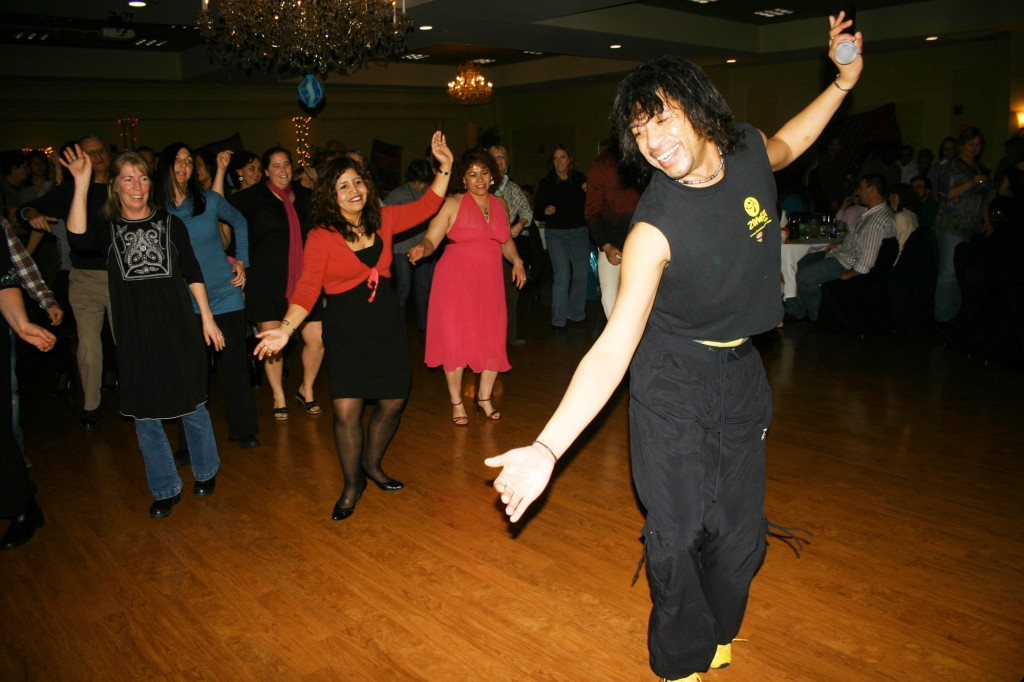 Tony Garreton (known as Tony Zumba) demonstrates Latin dance moves.