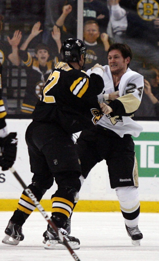 Boston's Shawn Thornton, left, went after Pittsburgh's Matt Cooke on Thursday in their first game since Cooke's controversial hit to the head knocked Bruin Marc Savard from the lineup.
