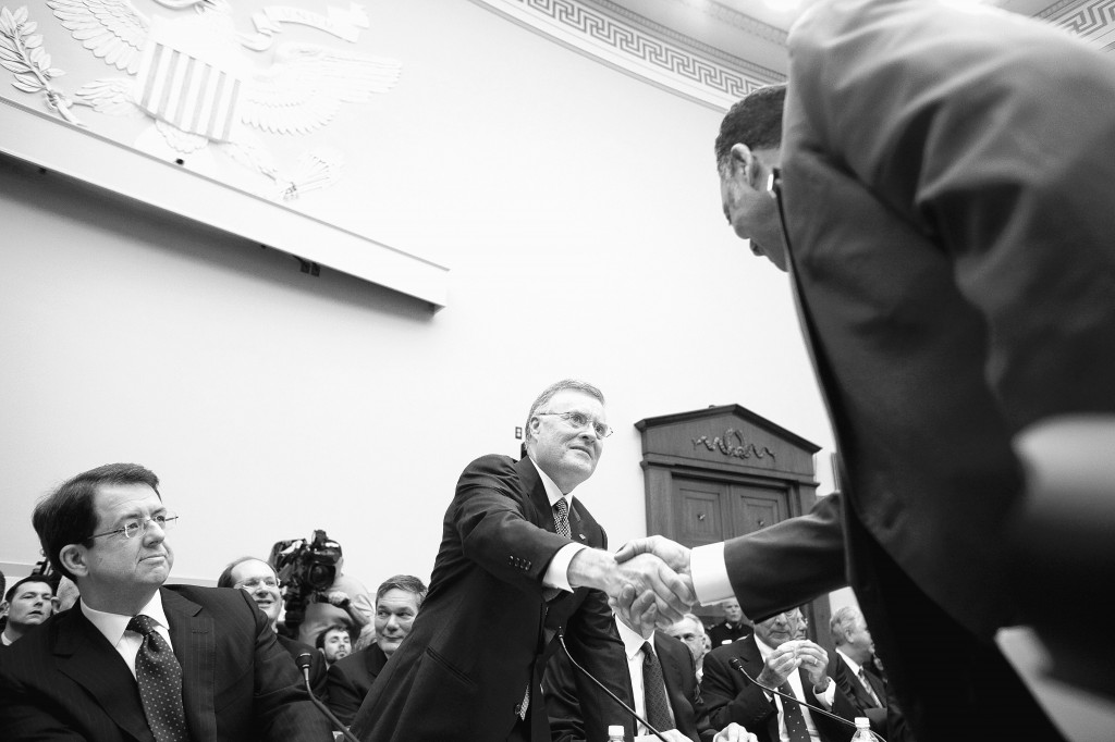 Ken Lewis of Bank of America shakes hands with the Rev. Jesse Jackson on Feb. 11, 2009, before testifying before the House Financial Services panel on how financial institutions have spent funds received from the Troubled Asset Relief Program. Recent court actions are putting pressure on the Federal Reserve to reveal information about those emergency loans.