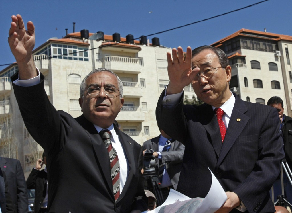 U.N. Secretary-General Ban Ki-moon, right, looks over Israeli settlements with Palestinian Prime Minister Salam Fayyad during a tour of the West Bank city of Ramallah on Saturday.