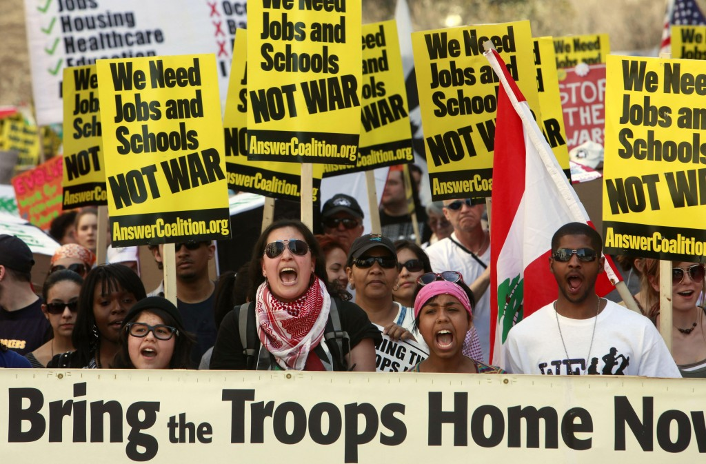 Anti-war protesters march through Washington on Saturday to protest the wars in Iraq and Afghanistan on the seventh anniversary of the invasion of Iraq. Despite at least eight arrests, the rally was peaceful.