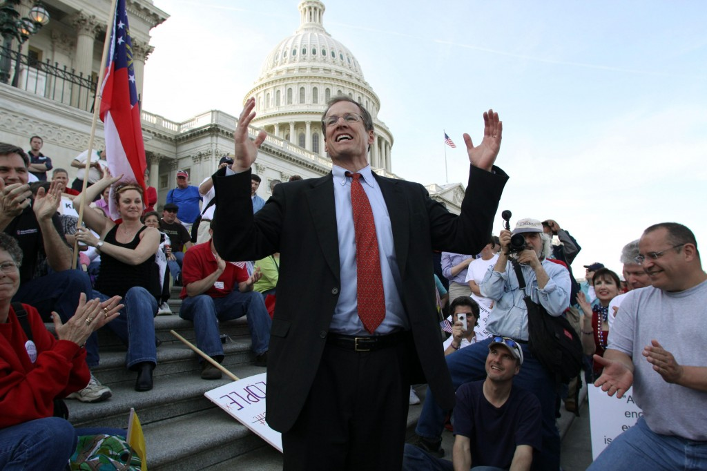 Rep. Jack Kingston, R-Ga., speaks to people demonstrating against the health care bill on the U.S. Capitol steps Saturday. Much about the day was noisy and emotional.