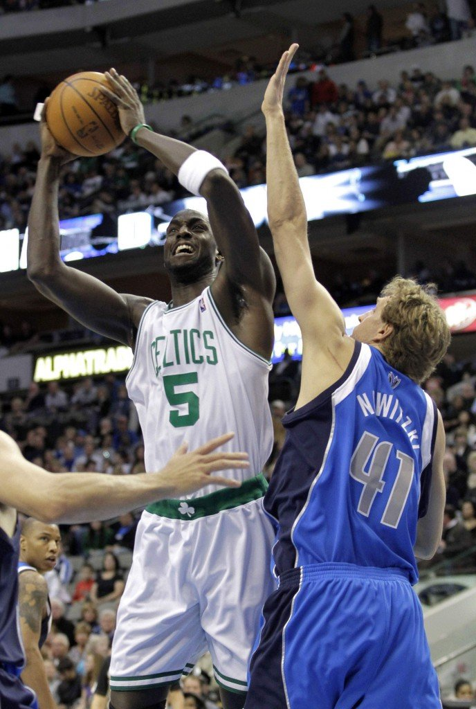 Kevin Garnett of the Boston Celtics heads to the basket in the first quarter Saturday night while guarded by Dirk Nowitzki of the Dallas Mavericks. Boston won, 102-93.
