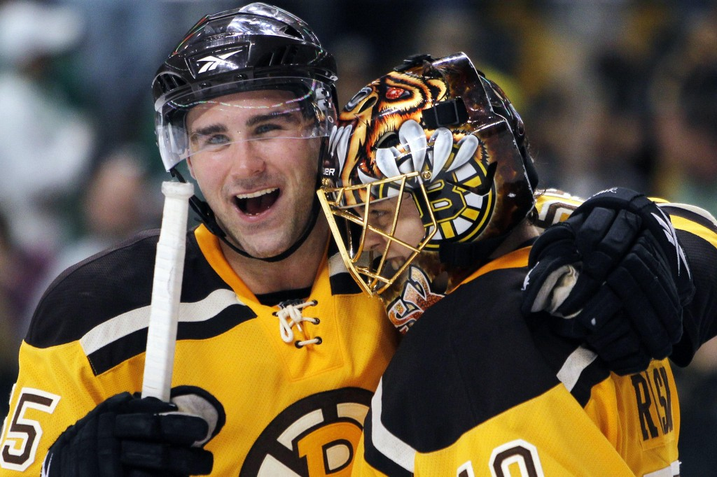 Bruins defenseman Johnny Boychuk, left, and goalie Tuukka Rask celebrate Boston's 2-1 win Sunday over the New York Rangers.