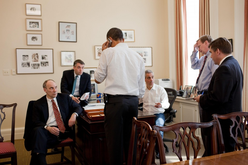 This photo provided by the White House shows President Obama talking on the phone with a member of Congress in the office of his chief of staff, Rahm Emanuel, at the White House on Sunday. Aides are, from left, Phil Schiliro, Sean Sweeney, Emanuel, Jim Messina and Dan Turton.