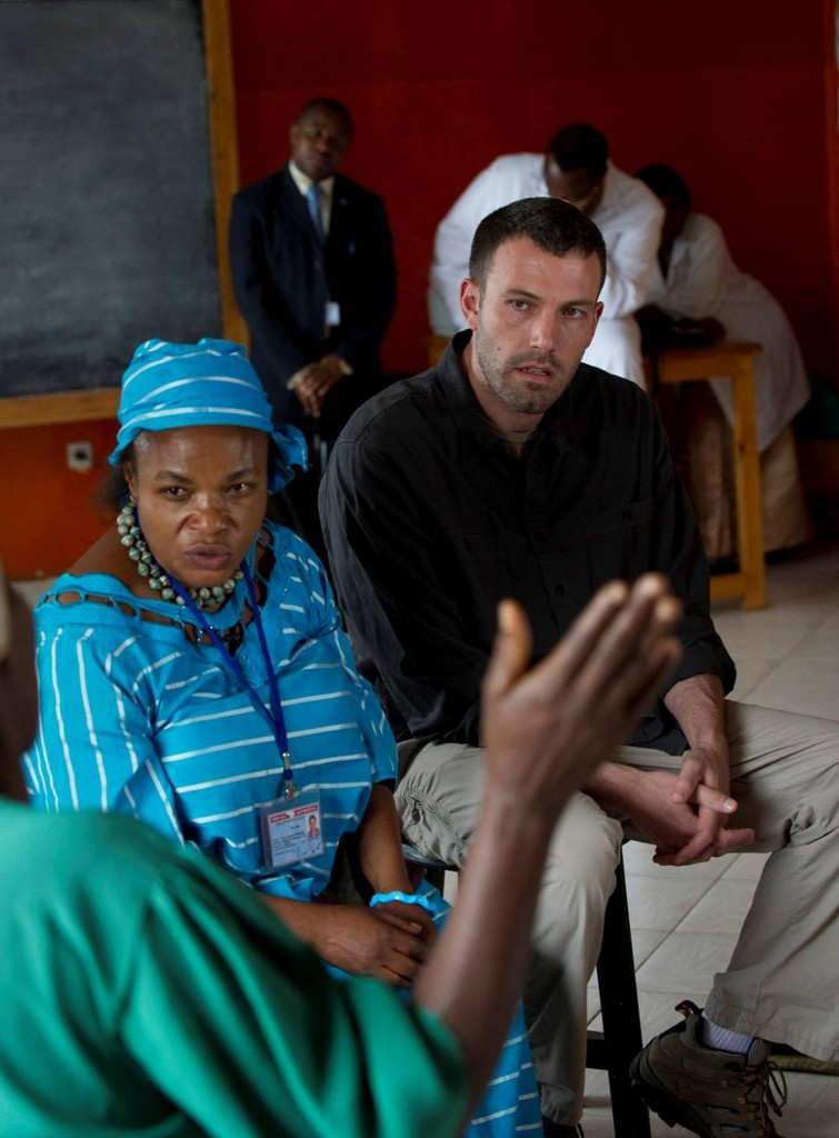Ben Affleck, founder of the Eastern Congo Initiative, and an official listen to a survivor of sexual violence at Aid Group HEAL Africa's premises in Goma, Democratic Republic of Congo on Thursday.