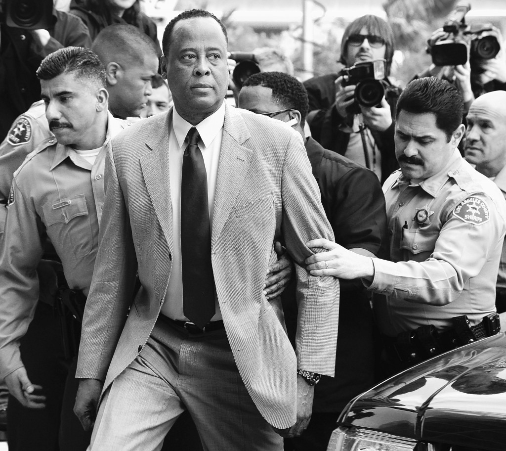 Conrad Murray, Michael Jackson's doctor, is escorted by Los Angeles County Sheriffs deputies on Feb. 8 as he arrives at the Airport Courthouse to face charges of involuntary manslaughter in the singer's death on June 25, 2009. Documents obtained by the Associated Press suggest he may have tried to conceal evidence.