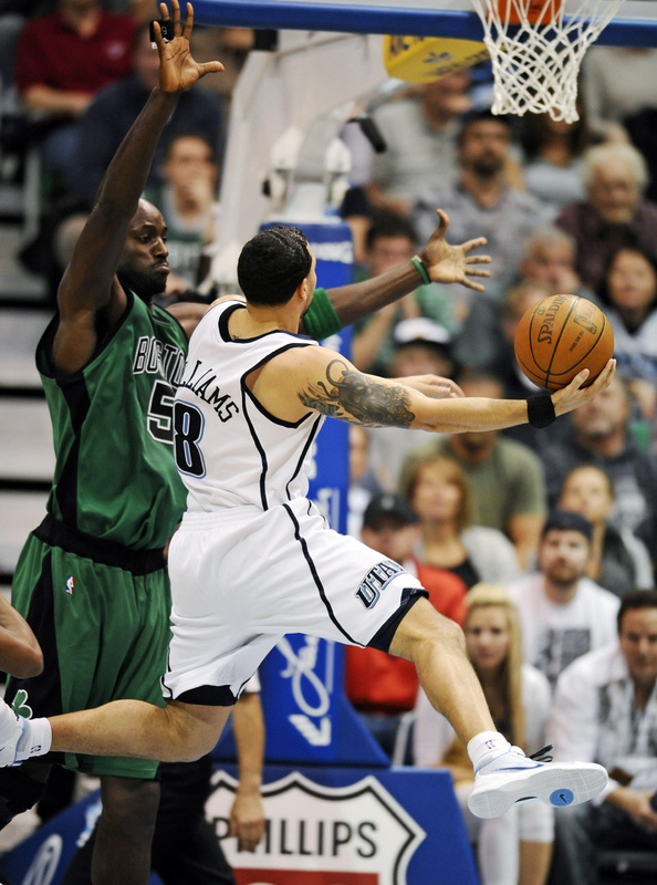 Utah guard Deron Williams drives to the basket against Kevin Garnett of the Celtics during Monday's game at Salt Lake City. Williams finished with 22 points and 11 assists, guiding the Jazz to a 110-97 victory.