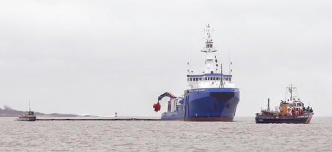 The U.S. Coast Guard vessel Shackle, right, passes by the Maine Responder during an oil spill cleanup drill in Portland Harbor on Wednesday. The scenario had an oil tanker leaking 2 million gallons of crude into Casco Bay after being struck by another vessel.