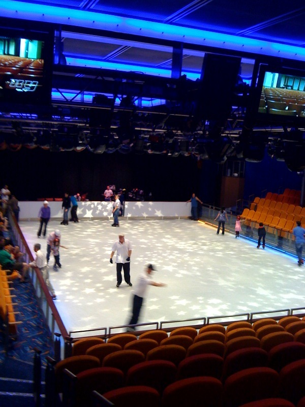 The skating rink is used by passengers during the day and for shows at night.