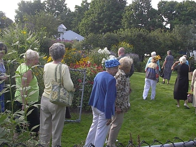 Southern Maine Garden Club members tour a garden in this 2008 photo. The members meet monthly and do various downtown beautification and other projects.