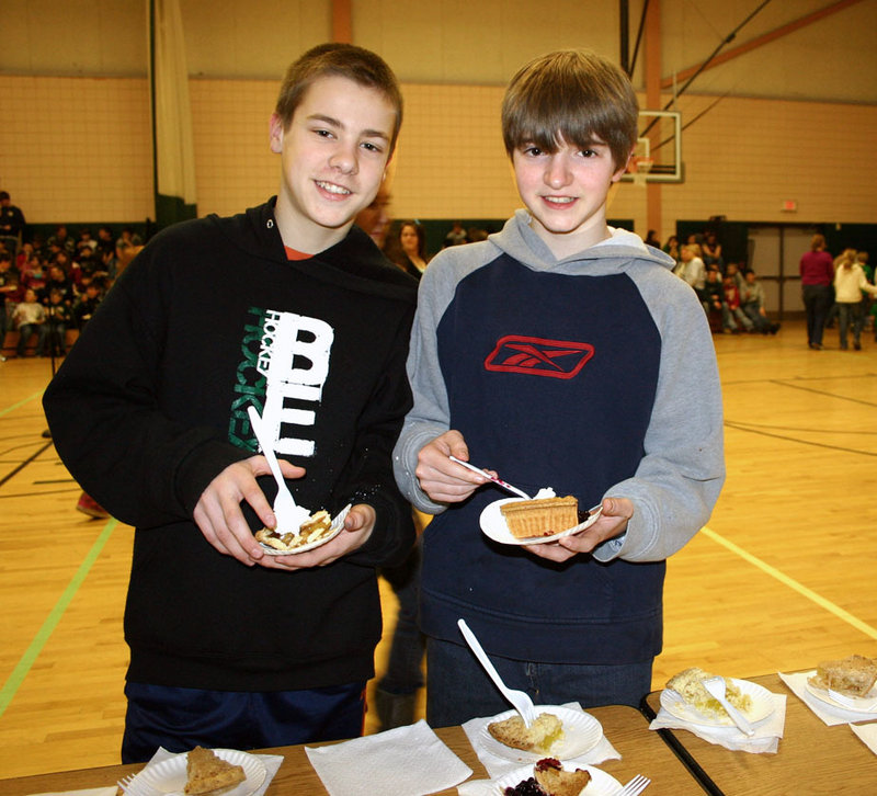 Bonny Eagle Middle School seventh-graders Justin Miles and James Maxwell chose their favorite pie and did math problems during the school's 16th Annual Pi Day.