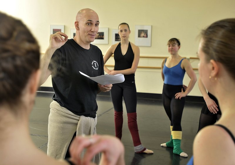 """Kennet Oberly, an international choreographer who used to be on the staff at Portland Ballet, created an original dance to accompany """"Requiem."""" He is shown here rehearsing with Portland Ballet dancers in February."""