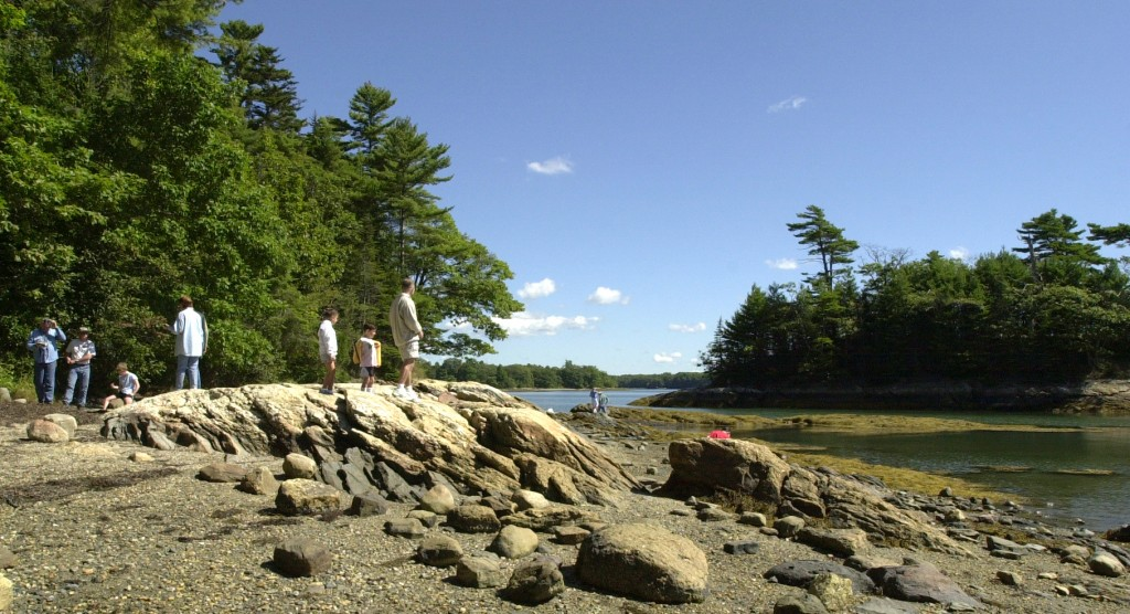 Hikers take in the view at Wolfe's Neck Woods State Park.