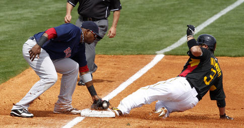Akinori Iwamura of the Pittsburgh Pirates slides safely into third base with a first-inning steal Wednesday, beating a tag by Jorge Jimenez of the Boston Red Sox. Boston won, 6-4.