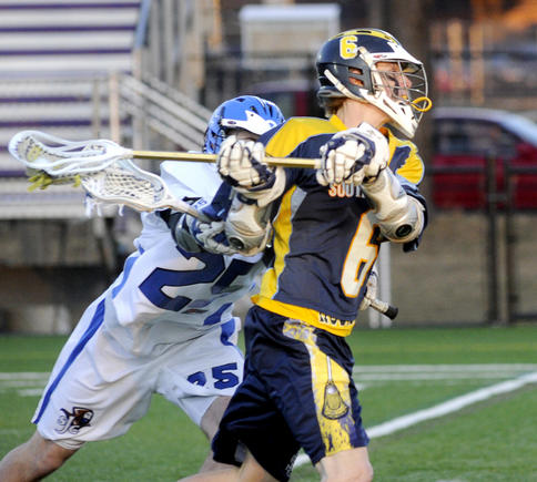 Dan Thomas of the University of Southern Maine snaps off a shot in front of Stephen Lucafo of St. Joseph's Wednesday night at Deering High. USM raced to an 18-5 win.