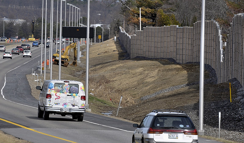"""The new sound wall follows the landscape along I-295 in South Portland – just past the barrier are about four dozen homes. """"It was loud constantly, 18-wheelers going by, """" said A.J. Ricci, who lives on Fellows Road."""