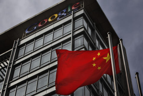 A Chinese flag waves below the Google logo outside the Google China headquarters in Beijing on Thursday. Google's decision to move its Chinese search engine offshore wins praise in the United States, but threatens to turn the company into a pariah in China.