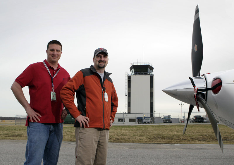 Kevin Plante, left, and Chris Presley, both air traffic controllers, ended up using a road map to guide an inexperienced pilot into the Portland International Jetport.