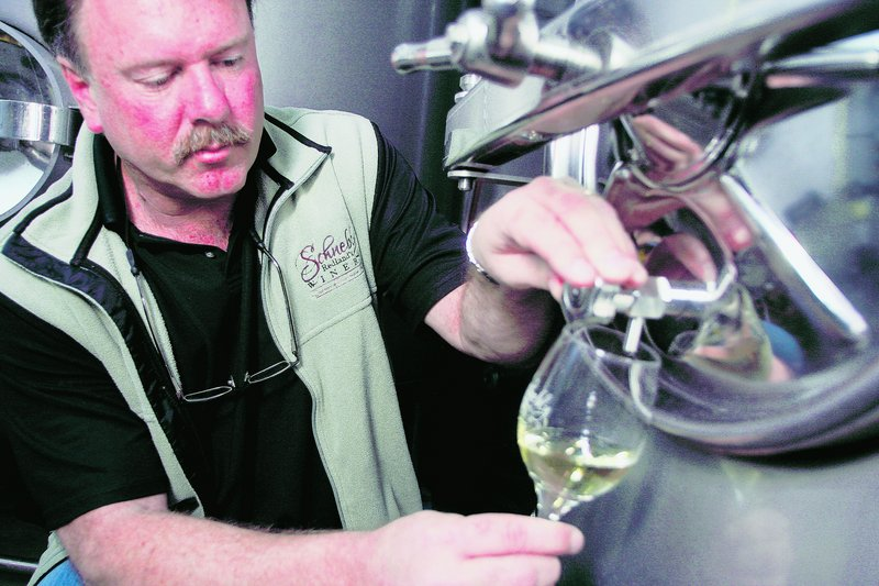 Peter Schnebly, co-owner of Schnebly Redland's Winery, takes a taste of its lychee wine. Miami-Dade County officials recently loosened restrictions on small-scale commercial ventures within farms to spur tourism.