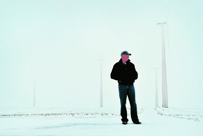 Dan Juhl, head of Juhl Wind, stands with some of his wind turbines in a Woodstock, Minn., field. Juhl Wind is a publicly traded company that develops community-based wind projects.