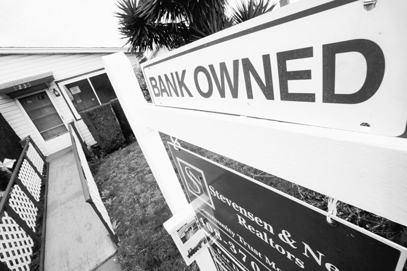 Foreclosed properties, like this one in East Palo Alto, Calif., are still a drag on the economy, so the Obama administration announced a plan Friday to reduce the amount some troubled borrowers owe on their home loans.