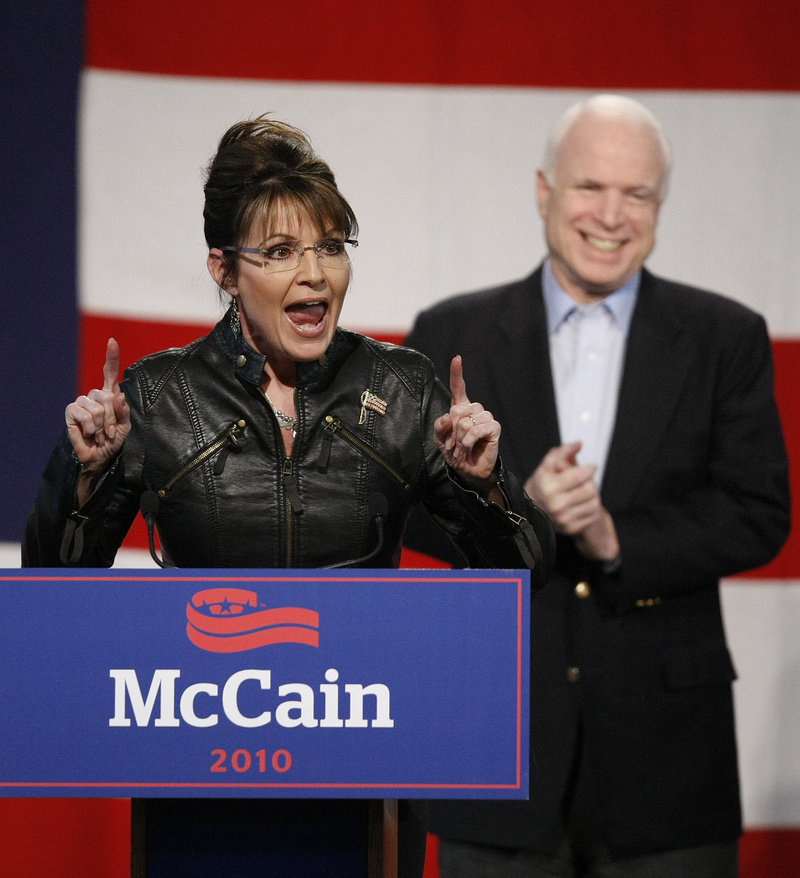 The Associated Press Sen. John McCain applauds former running mate Sarah Palin as she makes a point Friday at a campaign rally in Tucson, Ariz.