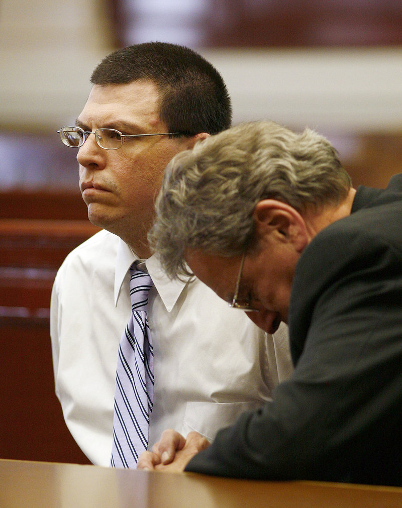 Michael Riley, left, is consoled by his attorney John Darrell on Friday in Brockton, Mass., after he was found guilty of first-degree murder in the prescription drug overdose of his daughter Rebecca in December 2006.