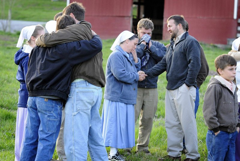 Friends and family grieve outside the home of John and Sadie Esh in Marrowbone, Ky. Eight members of the Esh family and two friends were killed Friday when a tractor-trailer crossed a median and collided head-on with their van.