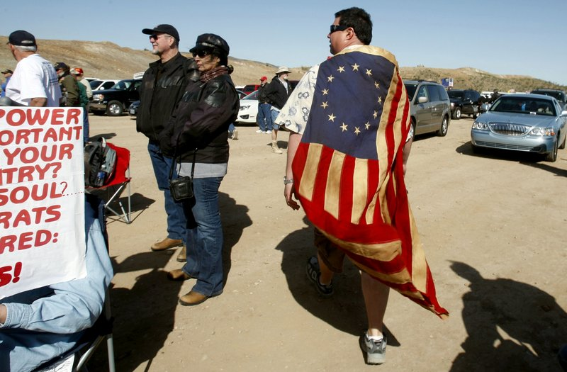 Matt Hall walks through the crowd at a tea party rally outside Searchlight, Nev., on Saturday. The rally kicked off a 42-city bus tour by the political action group Tea Party Express.