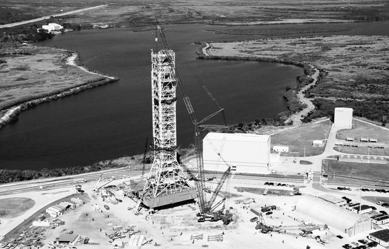 An aerial view shows the final segment of a new mobile launcher attached to the top of a 355-foot steel tower at NASA's Kennedy Space Center in Cape Canaveral, Fla. The launcher is being constructed to support the Constellation program, the back-to-the-moon effort initiated under President George W. Bush.