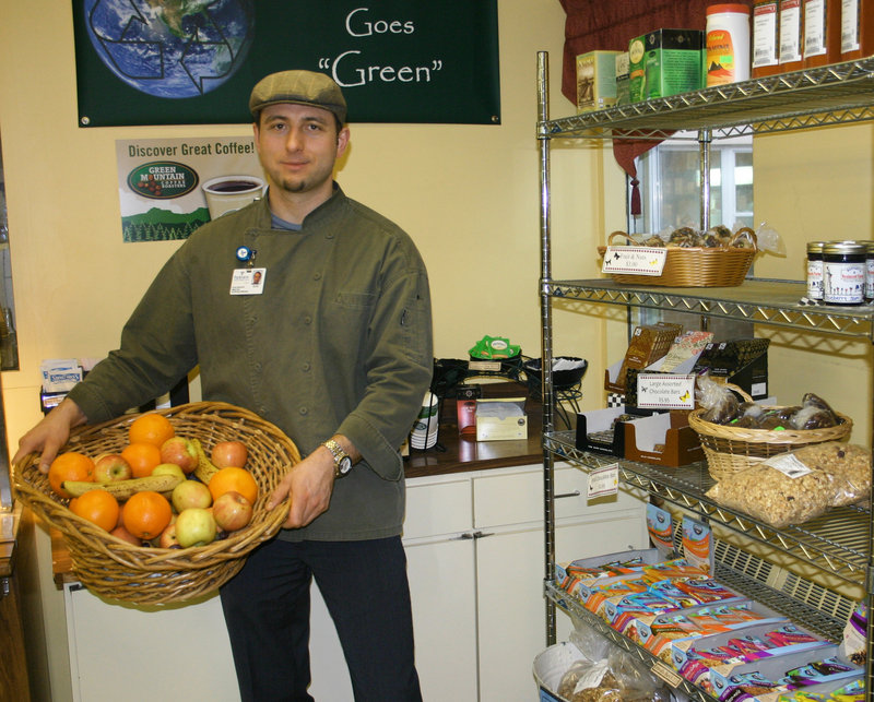 Chef Oleg Opalnyk shows off the free fruit for employees in Parkview Adventist Medical Center's all-vegetarian cafe.