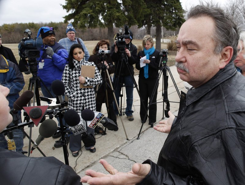 Arthur Budzinski, 61, right, a former student at St. John's School for the Deaf in St. Francis, and his daughter, Gigi Budzinski, left, who is interpreting for him, speak to members of the media at a news conference outside the Catholic Archdiocesan headquarters in St. Francis, Wis. Budzinski is one of some 200 deaf boys Rev. Lawrence Murphy is accused of molesting at St. John's School for the Deaf in St. Francis.