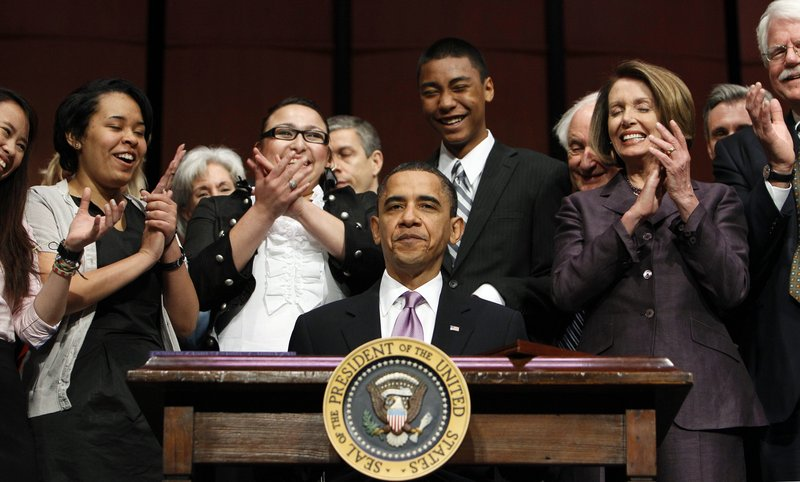 President Obama reacts Tuesday after signing the Health Care and Education Reconciliation Act of 2010 with Speaker Nancy Pelosi, D-Calif, right, students and others at Northern Virginia Community College in Alexandria. The bill shifts responsibility for student loans from banks to government.
