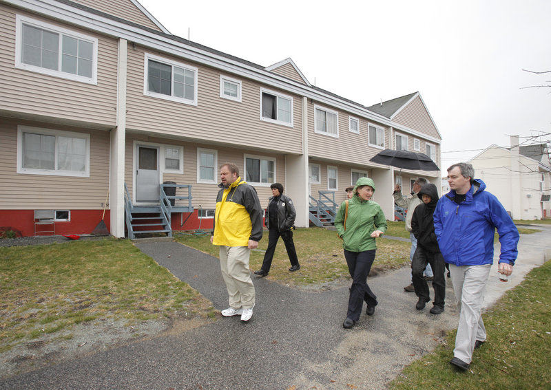"""Dave Rodgers, right, a Seattle engineer, and Neil Takemoto, a Washington planner, second from right, walk in East Bayside with Portland city planner Molly Casto and the Portland Housing Authority's David Gagne, left. A public meeting Thursday will focus on a """"vision"""" for East Bayside."""