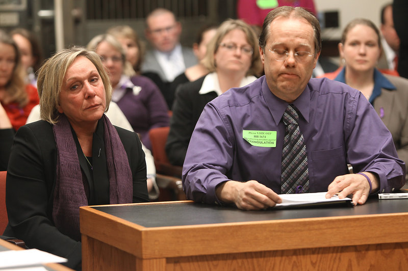 With his wife, Claire, beside him, John Cantin, whose daughter was killed by her estranged husband at her Manchester, N.H., home last year, testifies Tuesday for a bill that would make strangulation a felony-level crime.
