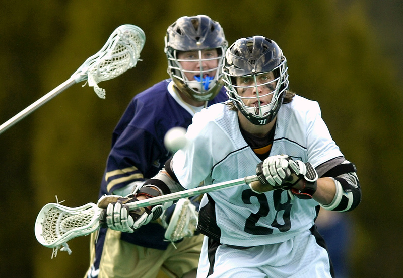 Brian Durkin of Bowdoin beats Trinity's Tim Reichert to the ball Saturday during a men's lacrosse game at Brunswick. Trinity rallied in the final period to pull out a 10-8 victory.