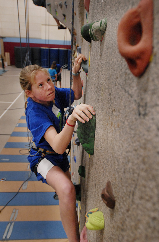 Marijke Rowse of Falmouth Middle School climbs the rock wall at Windham High School during the Teens to Trails Conference on April 4. Students came to learn fly-fishing, how to cook a campfire meal, how to start a fire and more in 70 seminars.