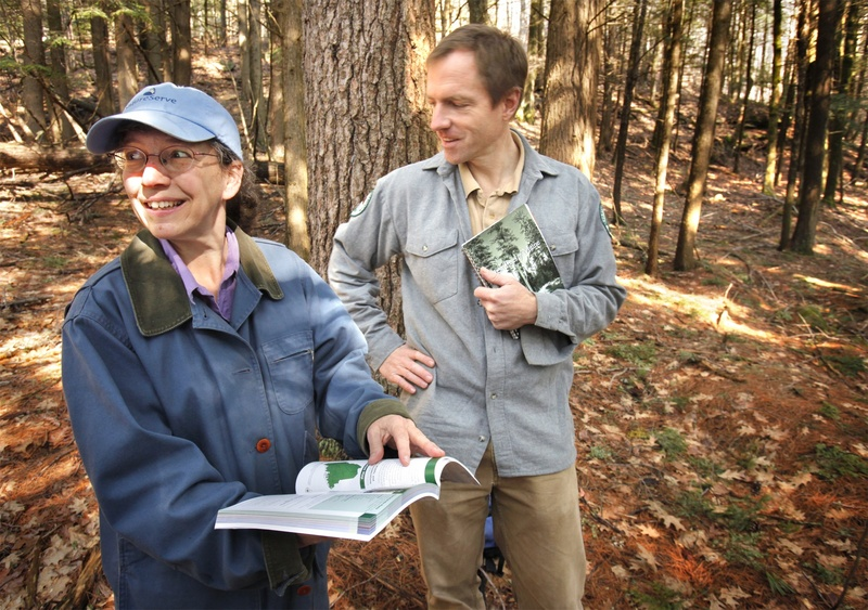 """Susan Gawler and Andrew Cutko talk about their book, """"Natural Landscapes of Maine,"""" in a hemlock forest at Bradbury Mountain State Park in Pownal last week. They pointed out three other natural communities besides the hemlock forest during a hike up the slope."""