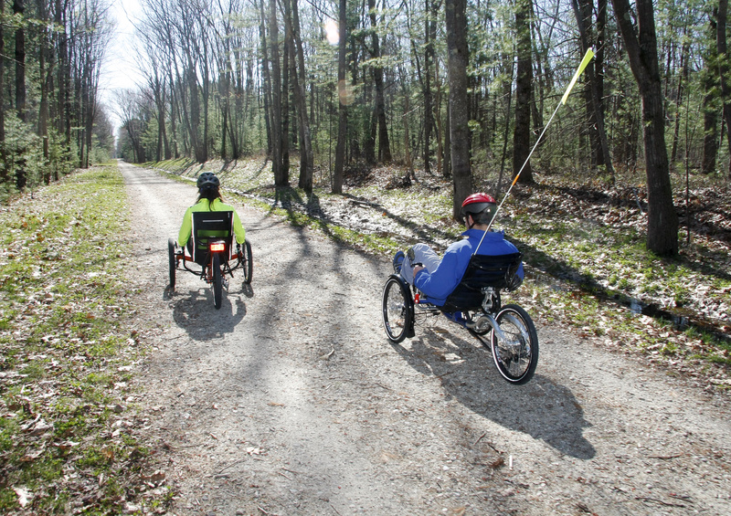 """Ethan Davis of Wildfire Human Powered Vehicles takes Outdoors reporter Deirdre Fleming for a spin on a recumbent tricycle near Scarborough Marsh. Of recumbents, Davis says: """"The biggest reason people want them is comfort. ... The biggest question people have is how safe it is in traffic."""""""