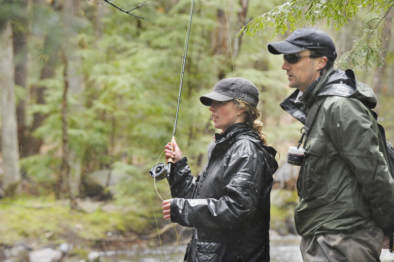 Maine Guide Greg Bostater teaches Shannon Bryan the basics of fly-casting and fishing.