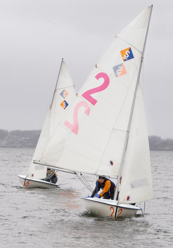 Portland High School freshman Patrick Robinson competes in the Bulldog Classic Regatta in Casco Bay in Portland on Saturday. Steering the boat but not shown is senior Parker Robinson.