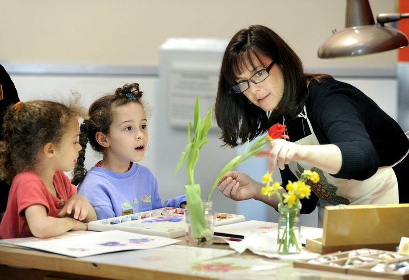 Focusing the young artists' attention on botanical still lifes, Yarmouth artist Kerry Charles works with 5-year-old Nina Chase and her sister Maya, 8, of Scarborough.