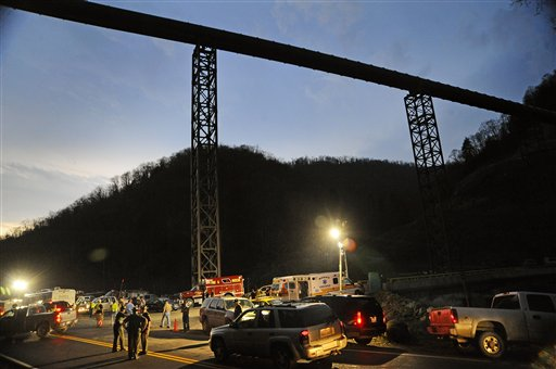 West Virginia State Police direct traffic at the entrance to Massey Energy's Upper Big Branch Coal Mine Monday, April 5, 2010 in Montcoal, W.Va. (AP Photo/Jeff Gentner)
