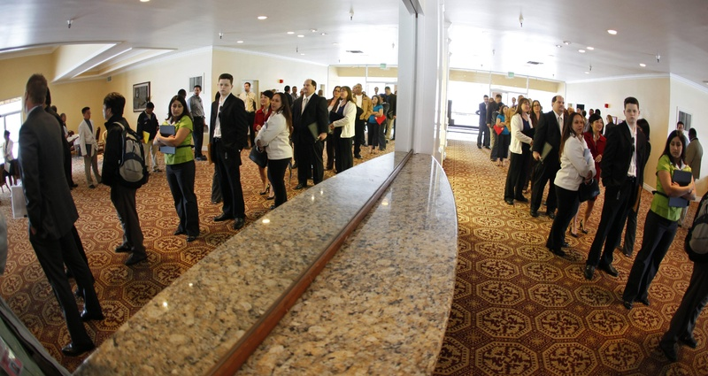 job seekers are reflected into a mirror while waiting in line to attend a career fair presented by National CareerFairs in San Jose, Calif. The Obama administration said Monday that huge deficits have been necessary to prevent an even deeper recession.