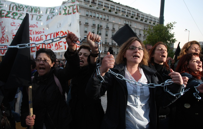 Unemployed schoolteachers chant slogans at an anti-government demonstration by civil servants Tuesday outside the Greek Parliament in Athens. The country's debt crisis has led to austerity measures, including thousands of job cuts.