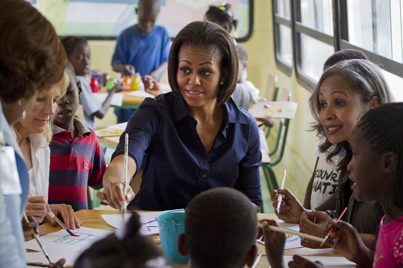 First lady Michelle Obama, Haiti's first lady Elisabeth Debrosse, right, and Vice President Joseph Biden's wife, Jill Biden, paint with children in a school in Port-au-Prince today during a surprise visit to the devastated Haitian capital.