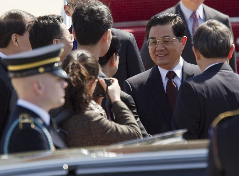 Chinese President Hu Jintao is greeted upon his arrival for the Nuclear Security Summit today, at Andrews Air Force Base, Md.
